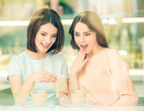 Girls sharing secrets Stock Image