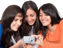 Girls sharing their photos Stock Photo