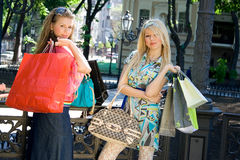 Girls after shopping. Nice girls after shopping in the center of the city Royalty Free Stock Photo