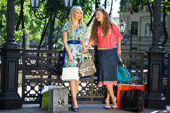Girls after shopping. In the center of the city Stock Photo