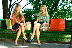 Girls after shopping. In the center of the city Royalty Free Stock Photo