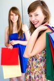 Girls with shopping bags. Two women with shopping bags stock photography