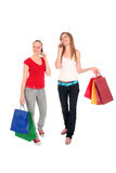 Girls with shopping bags. Happy young women with shopping bags, isolated royalty free stock photos