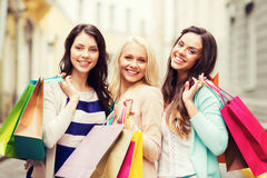 Girls with shopping bags in city Royalty Free Stock Image