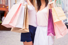 Girls with shopping bags. Stock Photo