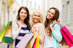Girls with shopping bags in ctiy. Shopping and tourism concept - beautiful girls with shopping bags in ctiy stock photo