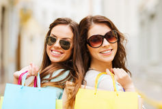 Girls with shopping bags in ctiy Royalty Free Stock Image