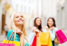 Girls with shopping bags in ctiy Royalty Free Stock Images