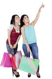 Girls with shopping bags looking copyspace Stock Photography