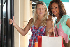 2 girls with shopping bags. Portrait of 2 girls with shopping bags Stock Images