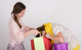 Girls with shopping bags Stock Image
