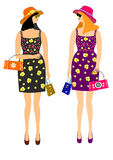 Girls with shopping in beautiful dresses Royalty Free Stock Photography