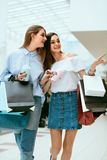 Girls Shopping. Female Friends In Mall. Girls Shopping. Beautiful Happy Female Friends With Colorful Bags In Mall. High Resolution Stock Photography