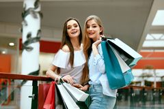 Girls Shopping. Female Friends In Mall. Girls Shopping. Beautiful Happy Female Friends With Colorful Bags In Mall. High Resolution Stock Image