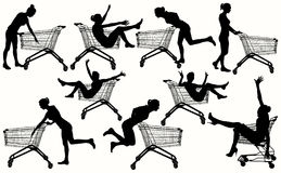 Girls with shopping cart. Stock Photos
