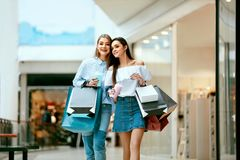 Girls Shopping. Female Friends In Mall. Girls Shopping. Beautiful Happy Female Friends With Colorful Bags Walking In Mall. High Resolution Royalty Free Stock Image