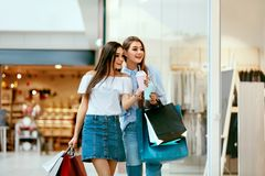 Girls Shopping. Female Friends In Mall. Girls Shopping. Beautiful Happy Female Friends With Colorful Bags Walking In Mall. High Resolution Stock Image