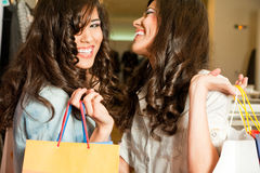 Girls shopping laughing Royalty Free Stock Photo