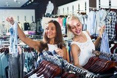 Girls shopping pair of denim shorts Royalty Free Stock Images
