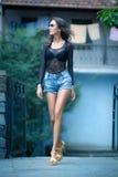Girls in short shortsand a dark blouse Stock Image