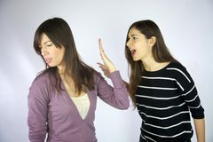Girls shouting at each other. Strong Royalty Free Stock Photography