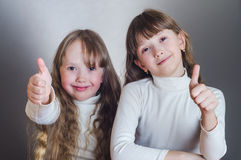 The girls show class. And smiling Stock Photography