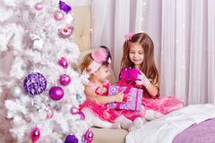 Girls show off the gifts for Christmas. Stock Photo