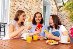Girls showing something to their mom on smartphone stock photography