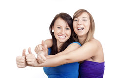 Girls showing thumbs uo Royalty Free Stock Photography