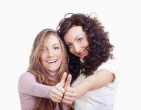Girls showing thumbs up Stock Photography