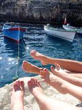 Girls shows legs Gozo island in the sun in summer, Malta. Azure Window, girls shows legs Gozo island in the sun in summer, Malta Royalty Free Stock Photo