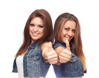 Girls shows thumb. Girls on a white background shows thumb Royalty Free Stock Photography