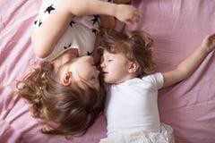 Girls siblings sisters talk, children's secrets, hug, relationsh Stock Images