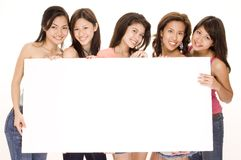 Girls and Sign #1. Five pretty young asian women hold a big blank white sign Stock Images