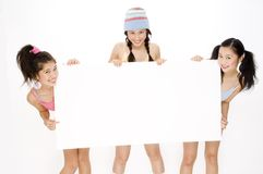 Girls and Sign Stock Images
