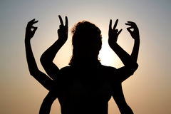 Girls silhouettes. With arms raised up outdoor Royalty Free Stock Photo