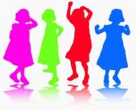 Girls silhouettes. Happy girls dancing Stock Photos