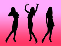 Girls silhouettes at pink. Girls silhouettes in night club dancing and posing Royalty Free Stock Photos
