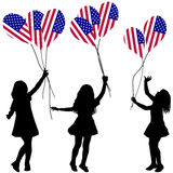 Girls silhouettes with US patriotic balloons Royalty Free Stock Images