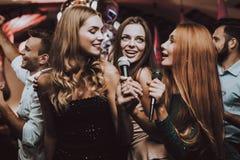 Girls Sing. Karaoke Club. Trendy Nightclub. Fun. stock photography