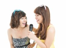 Girls singing karaoke Royalty Free Stock Photo