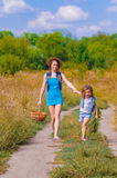Girls sister in a field with  flowers Royalty Free Stock Photography