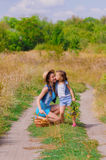 Girls sister in a field with  flowers Royalty Free Stock Photos