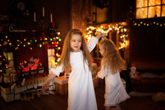 Girls sister friends dancing  Christmas tree, concept of  Christ Stock Photography