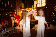 Girls sister friends dancing  Christmas tree, concept of  Christ Stock Photo