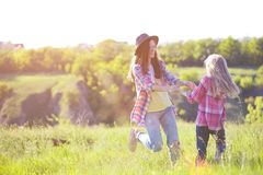 Girls sister at the meadow Royalty Free Stock Photography
