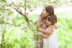 Girls sister with spring flowers, tender and love Royalty Free Stock Photos