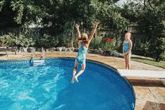 Free Girls Sisters Diving In Water On Home Backyard Pool. Children Siblings Friends Enjoying And Having Fun In Swimming Pool Together. Stock Photography - 195446702