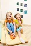 Girls sit on tumbling mats Stock Photography