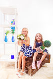 Girls sit on wooden boxes Royalty Free Stock Image